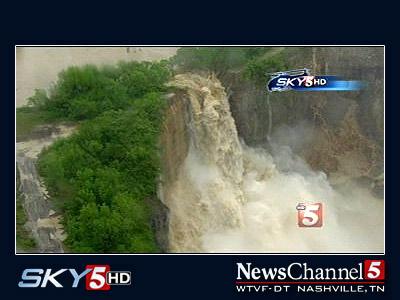 River bursting through a rock wall to create a waterfall.